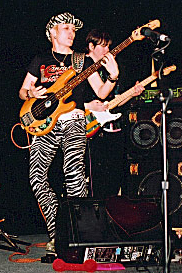 Slapping a bass solo for Superfreak at Lula Lounge Toronto, 2003. Five-piece band, 7 singers all on stage singing back-up for each other, a fab whack of disco hits.