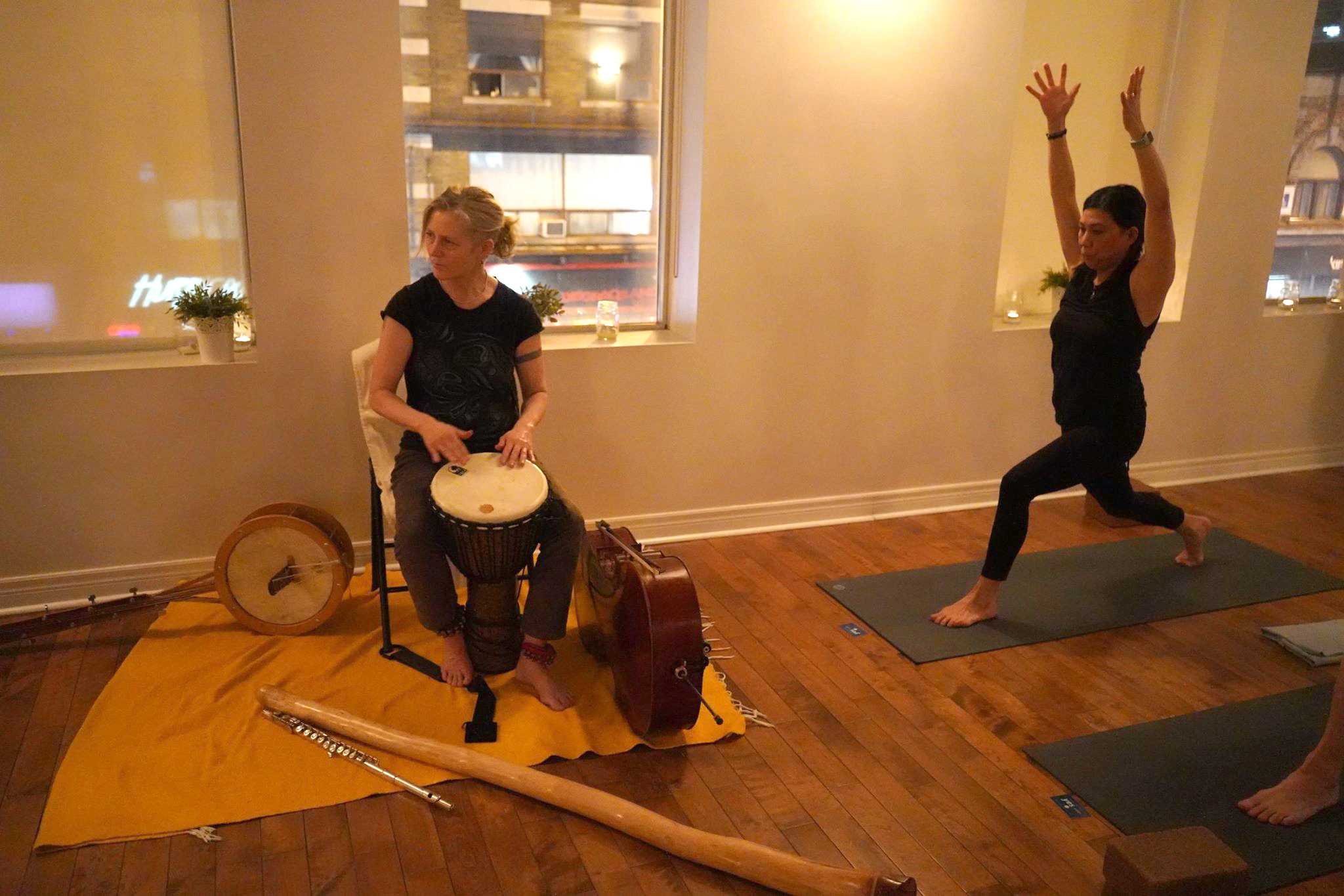 Playing djembe for Buddha On Fire charity yoga class, 2019. We produce this event a few times a year to benefit education for kids in a Nairobi slum.